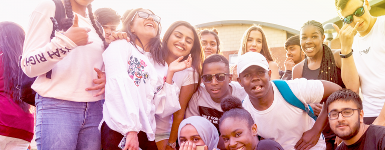 header young people gathered together taking a picture