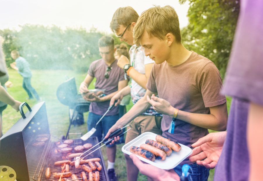 young people having a barbeque outside